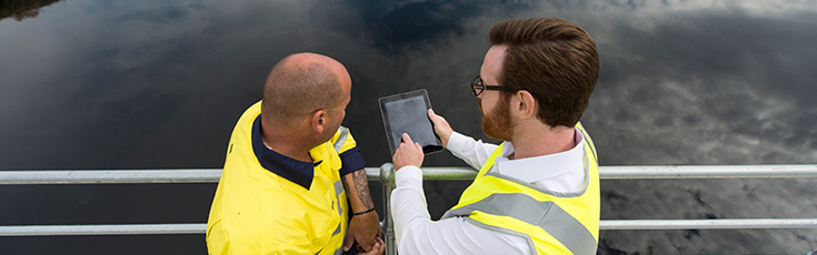 Workers looking at an iPad