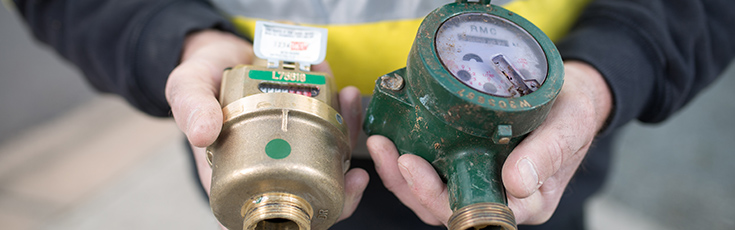 Water meter replacement program. An old meter and a new meter.