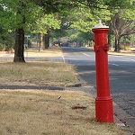 Red pillar hydrant on Canberra street